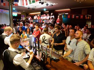 More relaxed times. Football fans packed into Jersey pubs for World Cup Football two years' ago. (Picture: Rob Currie 27615192)