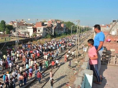 At least 60 killed as train crashes into crowd in India