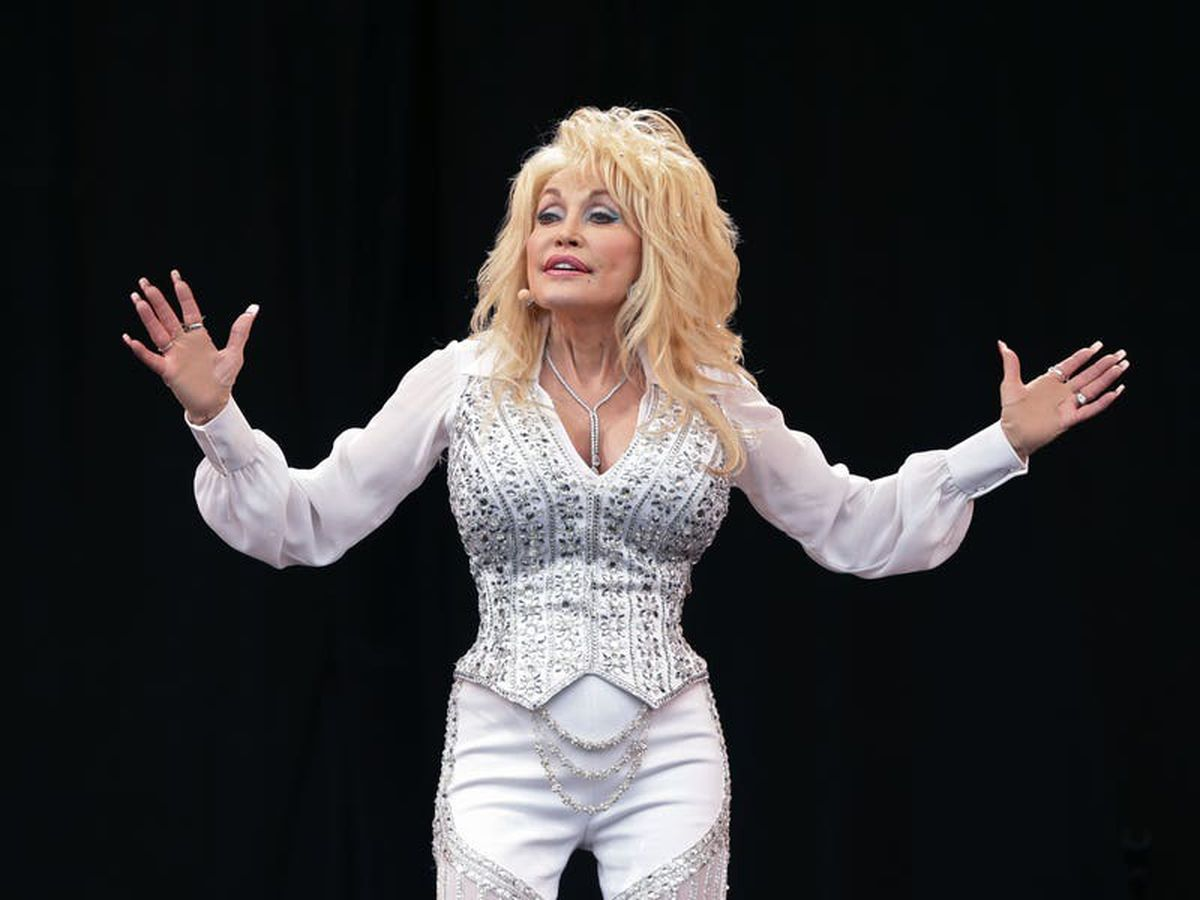 A taste of her own medicine: Dolly Parton gets Covid vaccine she partly funded
