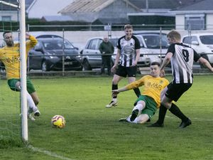 St Martin's No. 9 Dom Heaume scores the first goal of his hat-trick last night at the Corbet Field. (Picture by Adrian Miller, 29394048)