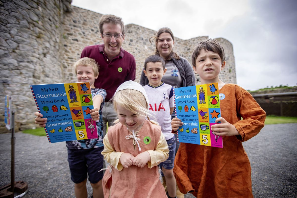 My First Guernesiais Word book launch at Castle Cornet. The book has been produced by Island Language to help teach children Guernesiaise from a young age. Left to right, back, Chris Dye and Bethan Batiste. In front, left to right, Eben Laine (7), Martine Dye (3), Charlie Mahy (7), Geoffrey Dye (6). (Picture by Sophie Rabey, 29849703)