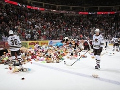More than 34,000 teddy bears thrown onto hockey rink in world record toy donation