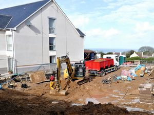 Picture By David Nash. 18-02-21 Alderney have started phase 1 of the exit from lockdown. Construction  work at the Connaught Old People's Home extension  ahas re-started this morning  in earnest after a three week lay off...Men are pictured  working at a safe distance.. (29869152)