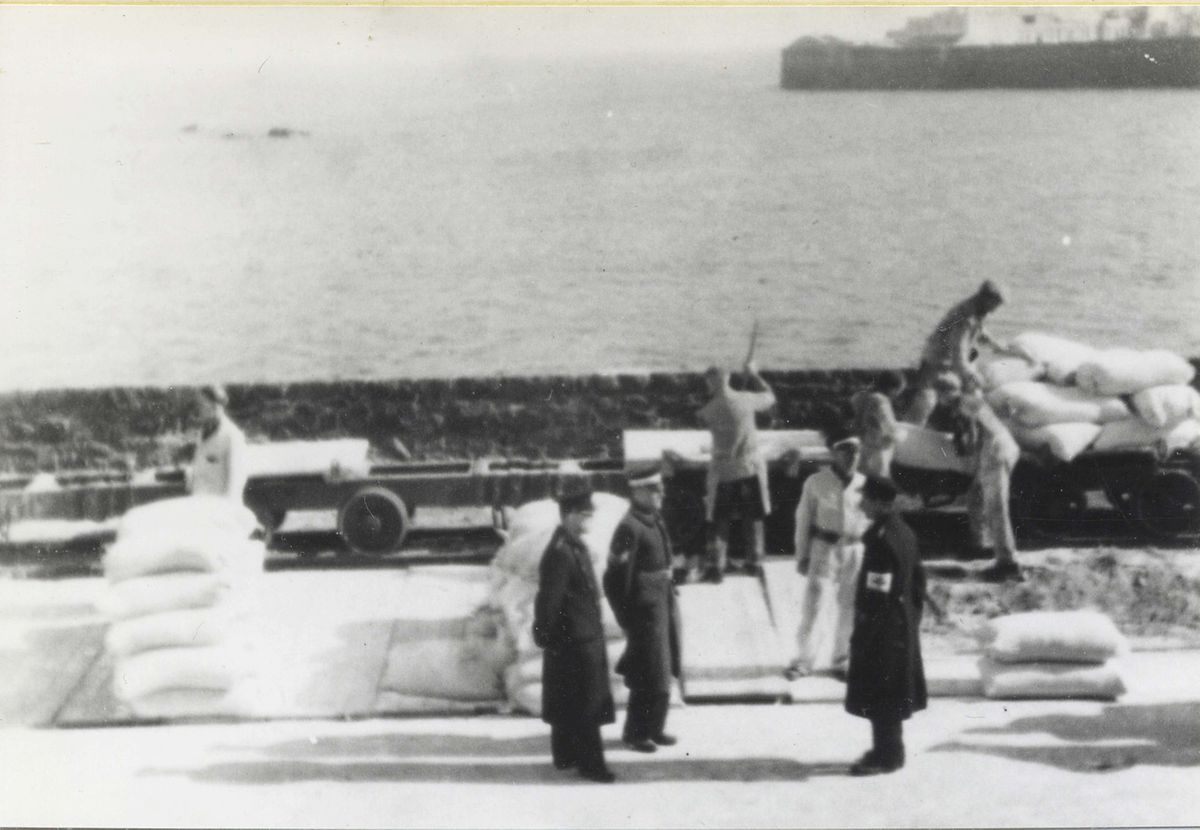 Copyright:  Gary Blanchford.Reg/Gary Blanchford.Rec Cross Ship the Vega delivered vital supplies to Guernsey, which were guarded and didtributed by St John's Ambulance personnel. (29513829)