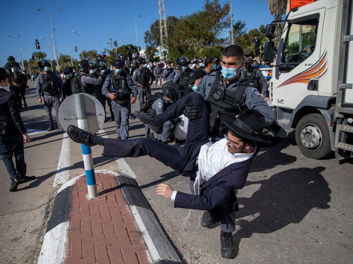 Israeli police clash with ultra-Orthodox protesters over school lockdown