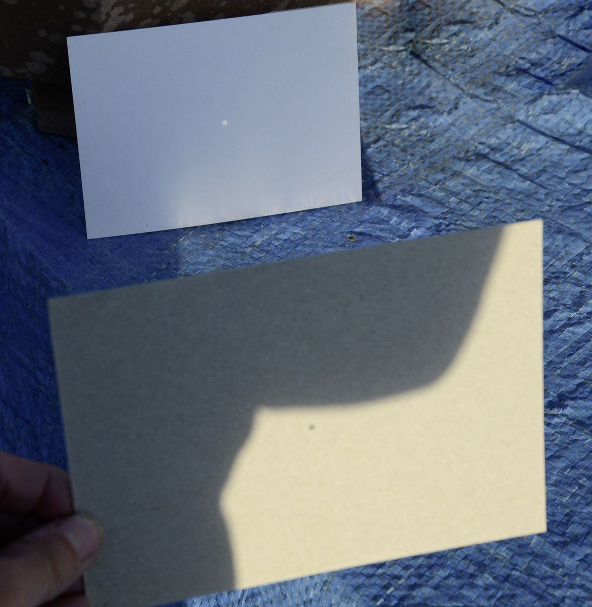 How to project an image of the Sun for safe viewing - simple pinhole projection with two pieces of card. This can be enclosed in a box for greater contrast, and the pinhole can be made in foil for a crisper image.  (29628355)