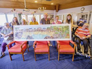 Guernsey Cheshire Home residents with their finished collage of Cobo. Arts for Impact's engagement director, Helen Bonner Morgan, and artist Ellie Atkinson have done a number of pieces like this over the years with residents and day visitors to bring the joy of art and creativity into the home, as well as raising funds. Left to right, Jenny Browning, Mrs Bonner Morgan, Anne Jehan, Jill Marquis, Paul de Jersey, Sarah Winsall, Ms Atkinson and Angela Gaskill.  (Picture by Sophie Rabey, 29597599)