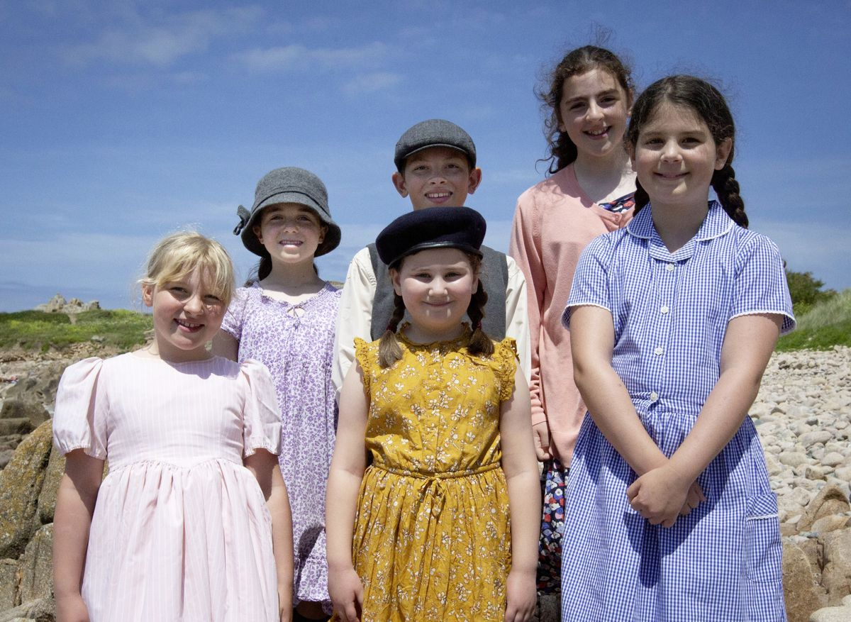 Left to right, Ines (11), Wills (11), Kelynn (11),  Alizah (8), Jenny (7), Evie (10). Filming at Les Grandes Rocques with La Mare De Carteret primary school for the A La Perchoine musical. (Picture by Cassidy Jones, 29633171)