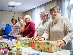 Many pitch in to help pack Rotary shoeboxes
