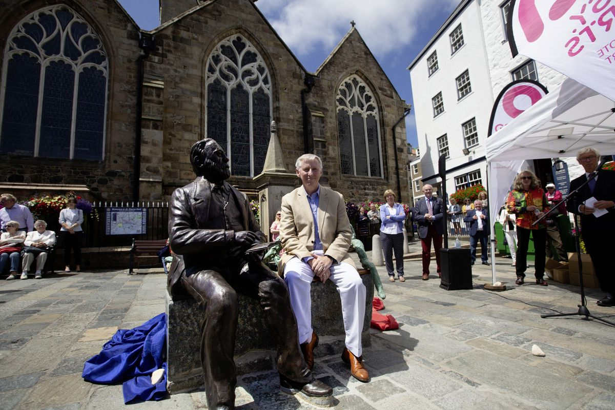 The Lt-Governor Vice Admiral Sir Ian Corder on the bench which is an integral part of the Victor Hugo sculpture after he and Lady Corder had unveiled it. (Pictures by Cassidy Jones, 29725726)