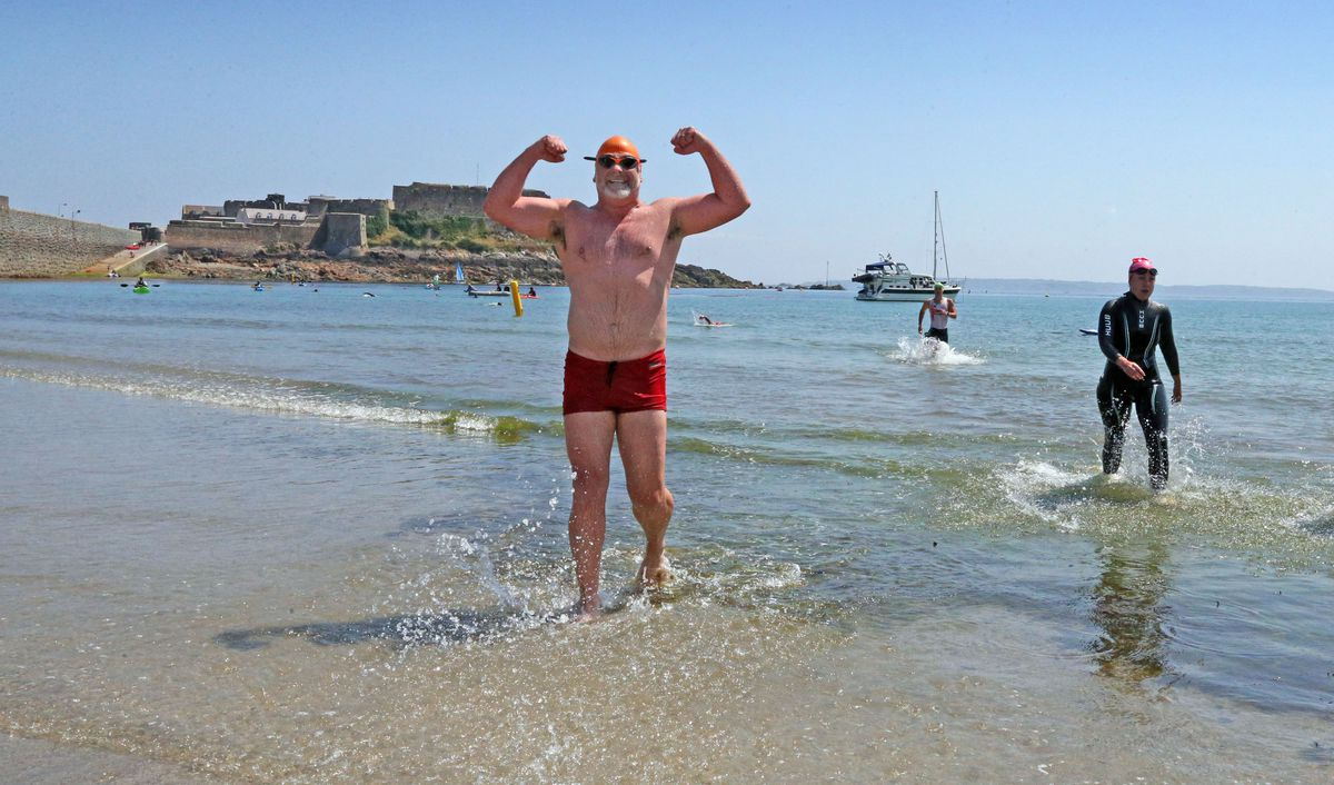 Adrian Sarchet warms up for one of his mammoth swims with a jaunt around Havelet Bay for the Credit Suisse Hel(l)vetia challenge in 2018.