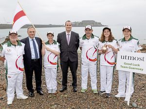 Pictured in the Team Guernsey kit are Giga chairman Brian Allen, flag-bearer Nikki Trebert (shooting), Giga games director Jon Marley and water-carriers Oriana Wheeler (swimming) and Emma Sykes (basketball) along with representatives from Utmost. (24865483)