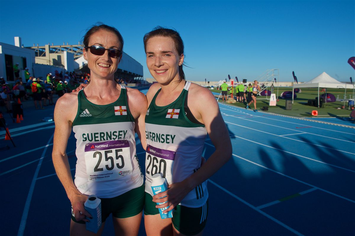 Island Games Gibraltar 2019 IG 2019. Athletics. Women's 10,000m final. L>R second placed Jenny James, GSY and winner Sarah Mercier, GSY                                                               Picture: ROB CURRIE. (26470899)