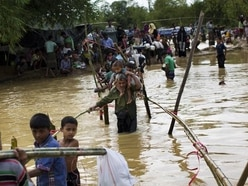 Rohingya refugees struggle with monsoon rains and extortion gangs in camps