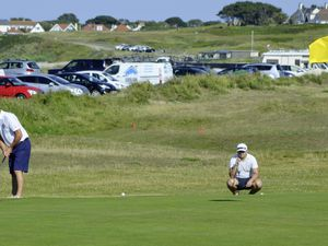 GOLF De La Rue Shield match between Royal Guernsey GC and L'Ancresse GC, 28-07-19. Neil Tanguy putts on the 16th watched by opponent Sean Mills..Picture by Gareth Le Prevost. (25374757)