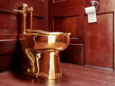 Enigmatic artist who made £4.8m gold toilet denies theft was a prank