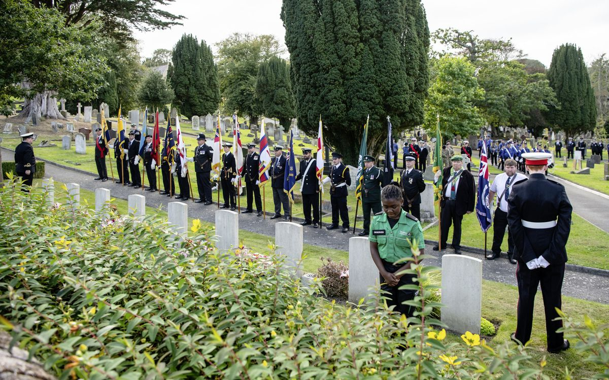 A St John Ambulance member laid a wreath at yesterday's remembrance service. (Pictures by Andrew Le Poidevin)