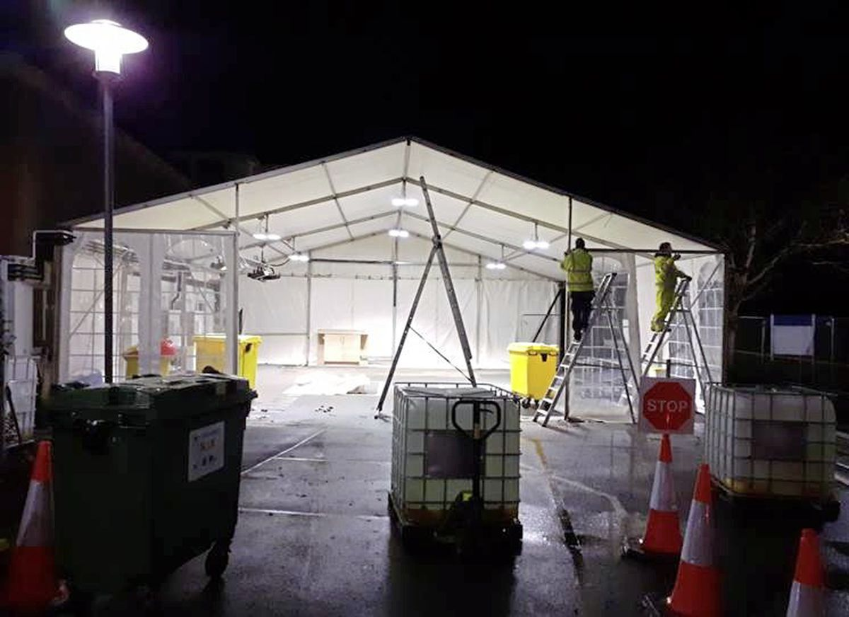 The drive through testing centre at the Princess Elizabeth Hospital nearly doubled in size at the weekend. Between 11pm on Sunday night and 3am Monday morning, the Estates Team provided the swabbing teams with an additional 4.5 metres of capacity by extending the testing tent. This will allow four cars to be undercover at any one time and the flow through the tent will be more efficient. (29160062)
