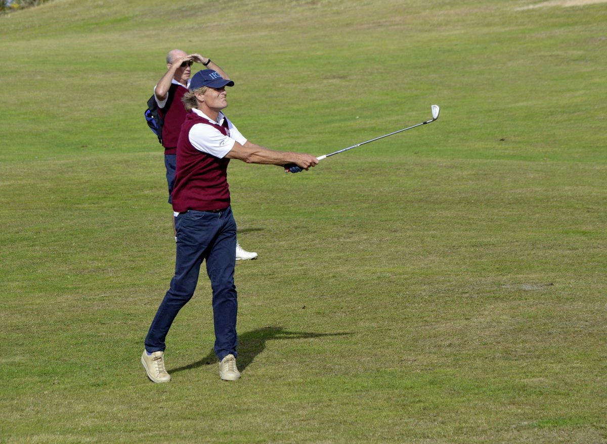 Daniel Griggs hits his approach at the first hole into the teeth of the wind. (Picture by Gareth Le Prevost, 28515227)