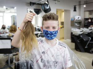 Jacob Morgan, 10, holds his foot-long hair which was cut off on Saturday after it took him three years to grow. The Little Princess Trust is a double beneficiary. (Pictures by Adrian Miller, 29331638)