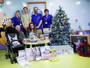Picture by Cassidy Jones. 24-11-20 Helping Jonah Helping Others charity present gifts to Frossard Ward at the PEH. L-R - Front are Geoff and Sonia Gillingham, back are L-R - Allie Winterton, snr staff nurse, Jonah Gillingham, Jonathan Spencer, staff nurse and Carolyn Morley, staff nurse.. (28948935)