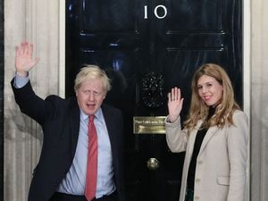 Prime Minister Boris Johnson and his girlfriend Carrie Symonds arrive in Downing Street after the Conservative Party was returned to power in the General Election. (Picture by Yui Mok/PA Wire)