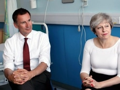 Hunt urges Tories to back May after backlash over extended transition