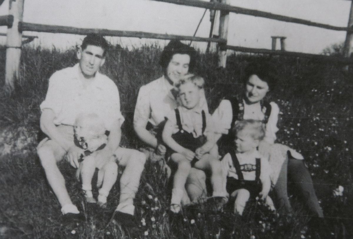 A picture taken in the Biberach just after it was liberated. Left to right, Sidney Skillett, holding their son David, Gladys Skillett, holding their son Colin, and family friend Maria Koch with her son Heiner.