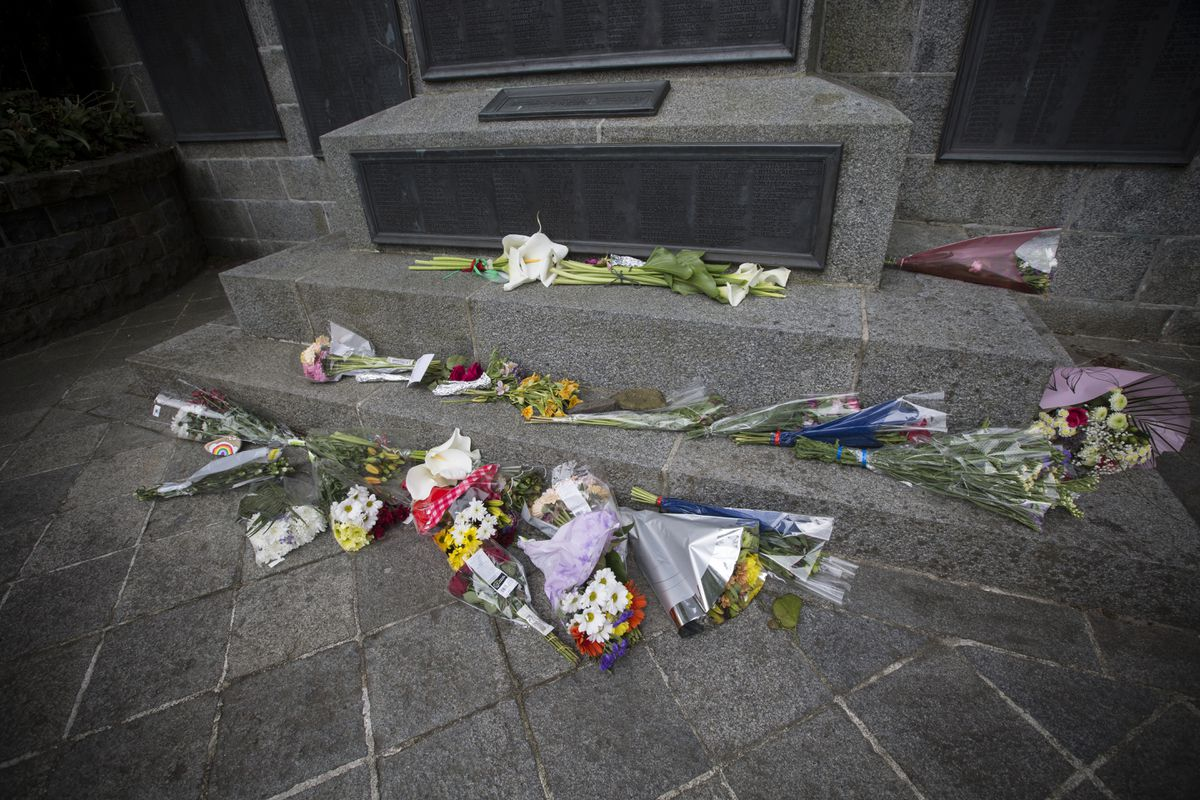 People left flowers on the War Memorial in Smith Street on 11 May 2020 after the wreath laid the then-Bailiff Sir Richard Collas was vandalised. (Picture by Adrian Miller, 29417590)