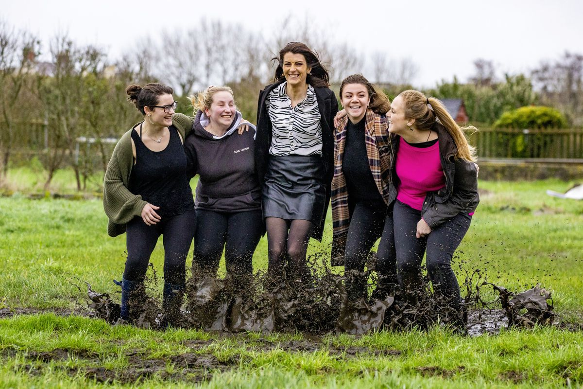 Guernsey Press staff Emily Hubert, Cassidy Jones, Ashley Miles, Zoe Fitch and Sophie Rabey donned wellies and jumped in a mucky puddle to raise money for Cancer Research UK. (Picture by Peter Frankland, 29103942)
