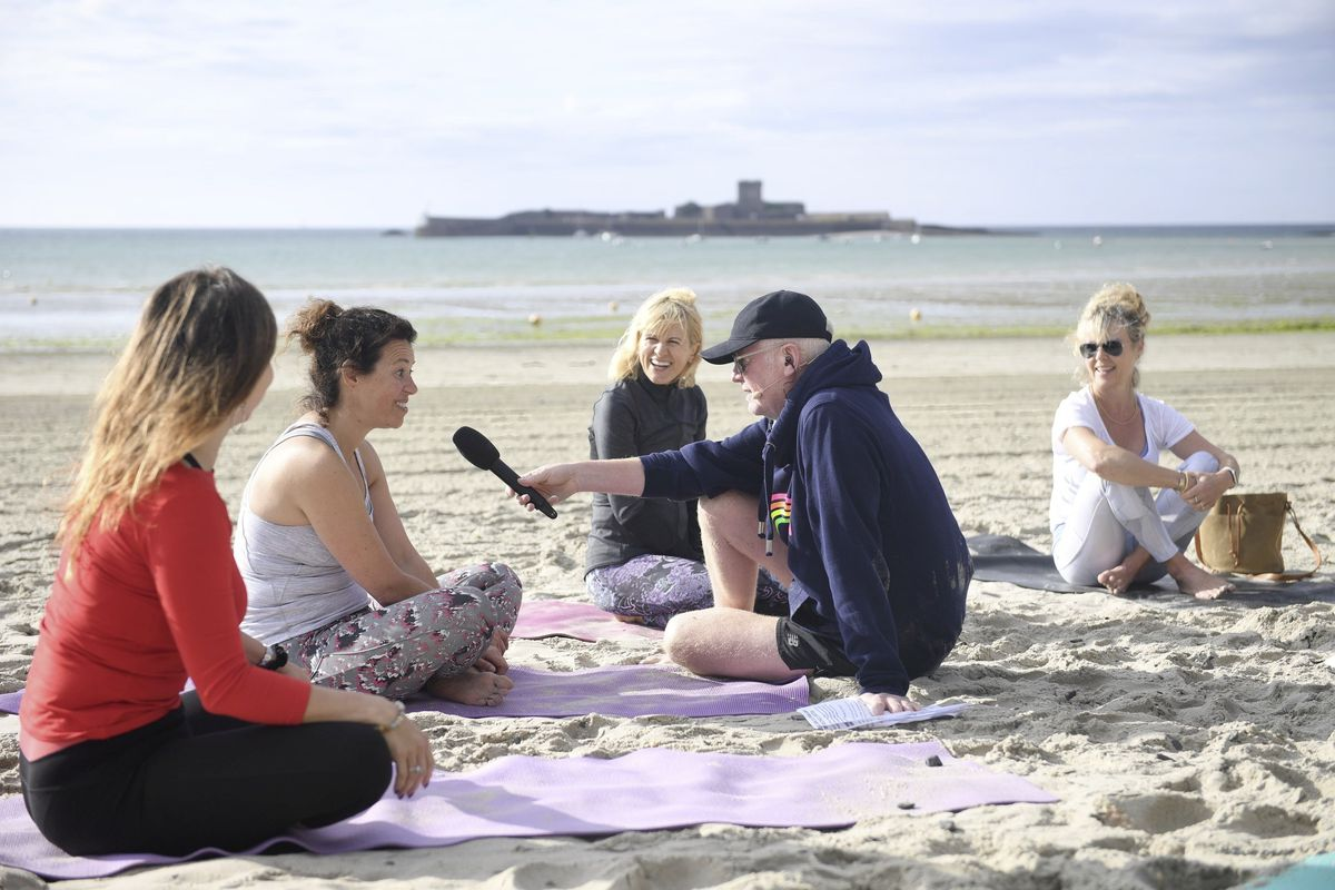 Chris Evans broadcast his Virgin Radio breakfast show live from Jersey yesterday, including a segment on yoga on the beach. (Picture by David Ferguson, 29843915)