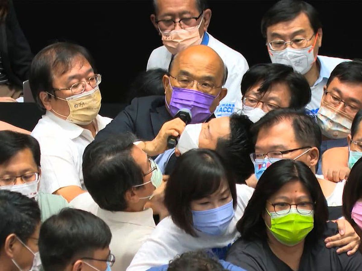 Taiwan's politicians brawl after opposition rushes the podium