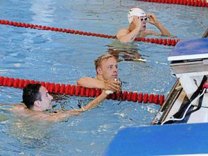 Swim team coach is given golden birthday