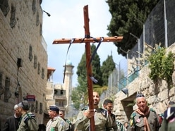 Christian pilgrims march through Jerusalem for Good Friday