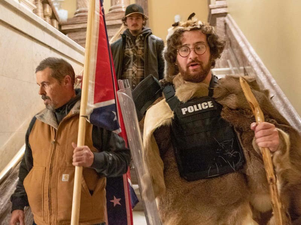 Man carrying Confederate flag during Capitol riot arrested