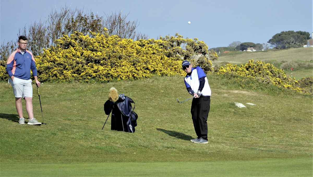 Arthur Evans chips watched by playing partner Ollie Chedhomme. (Picture by Gareth Le Prevost, 29501643)