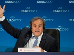 Platini vows to return to football after Swiss justice move