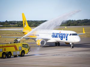 The first air bridge flight from the Isle of Man was given a water cannon welcome from the airport fire service. Its popularity has been a rare bright spot for Aurigny. (Picture by Sophie Rabey, 28555310)