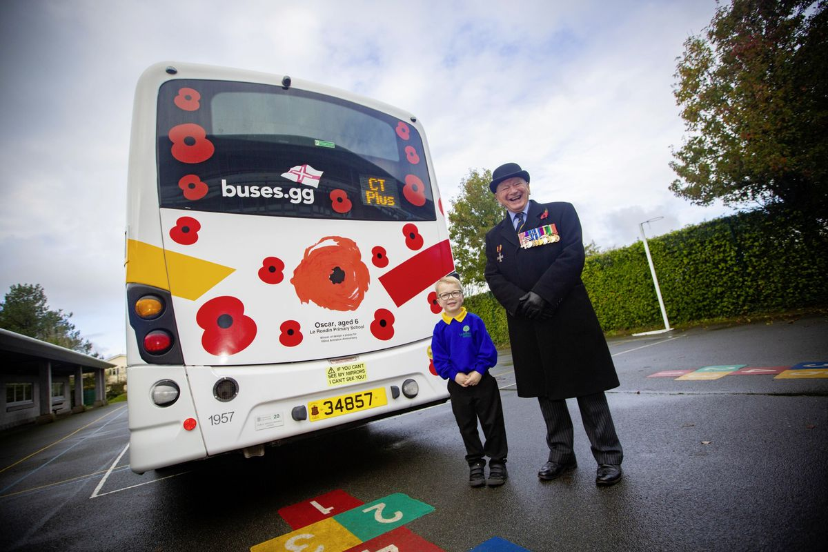 Le Rondin School pupil Oscar Frise, 6, has won the first prize in the CT Plus competition to design a poppy for the 'Poppy Bus'. His design is now painted on the back of the bus and will remain there for a year. He is pictured alongside the Royal British Legion's Bob Place. (28896637)