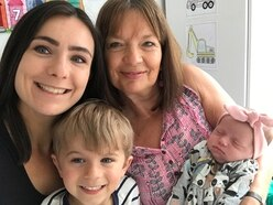 First cuddle with granddaughter as lockdown restrictions ease