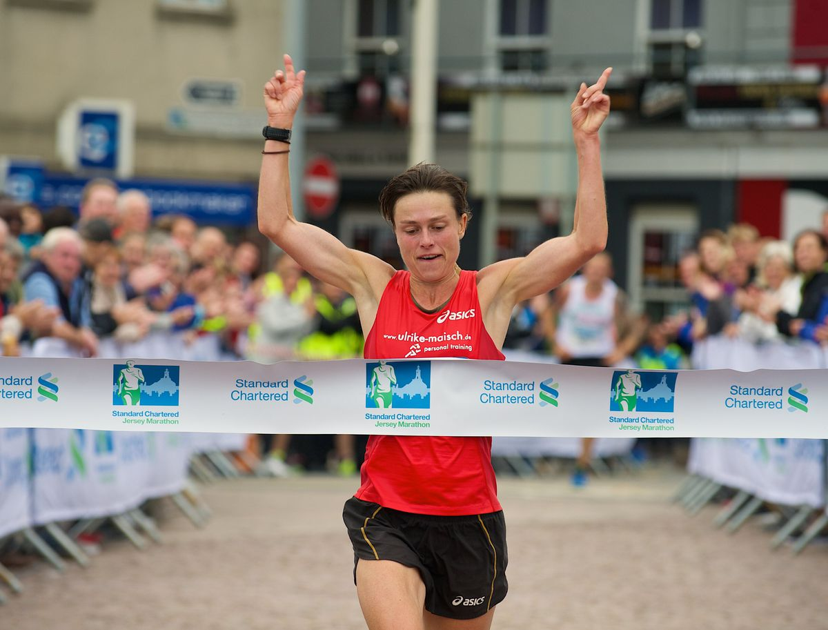 Guernsey's outstanding distance athlete Ulrike Maisch breasts the tape to win the Standard Chartered Jersey Marathon at the finish at Weighbridge Square. (Picture by Rob Currie, 19484299)