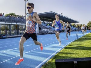 Running down the clock: Chris Bain leads Alex Rowe through the bell as the island's current No. 1 800m runner progresses towards another two-lap triumph at Footes Lane in a solid time of 1-55.62. (Picture by Martin Gray)