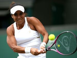 Heather Watson in action against Anett Kontaveit on day three of the Wimbledon Championships at the All England Lawn Tennis and Croquet Club, London. (Picture by Steven Paston/PA Wire, 25122598)