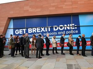 People queuing outside the Manchester Convention Centre for last week's Conservative Party Conference. (Stefan Rousseau/PA Wire)