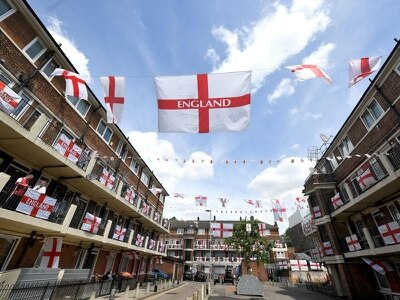England stars call fan behind flag-covered estate