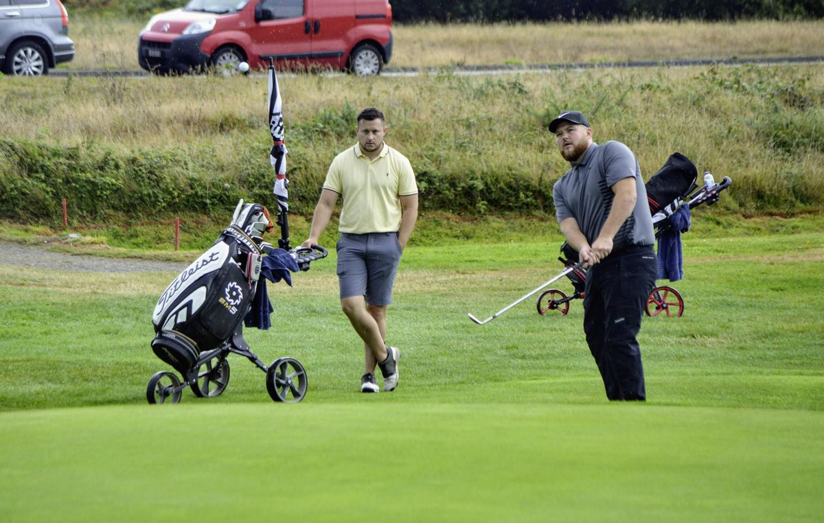 The new Guernsey men's champion Tom Le Huray and his caddie Sean Mills. (Picture by Gareth Le Prevost, 28587244)
