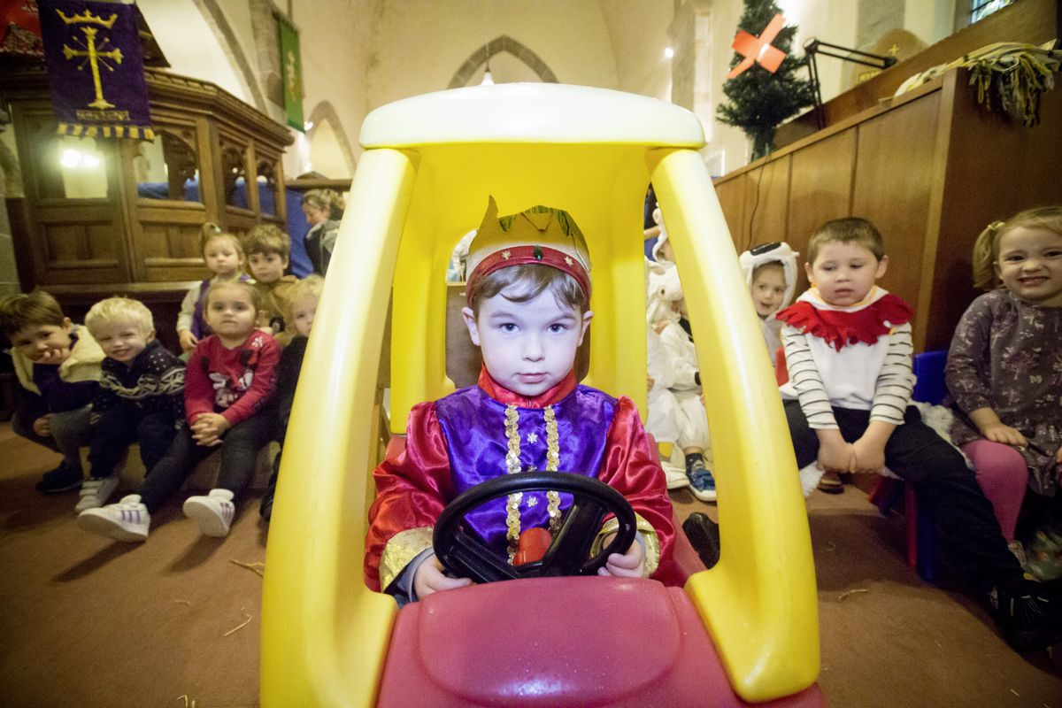 Children from Little Buttons preschool are busy rehearsing their Christmas nativity promoting good reading habits and sign language. Pictured is 'The King' Ozzie Terpstra driving the car. (Picture by Adrian Miller, 28979443)