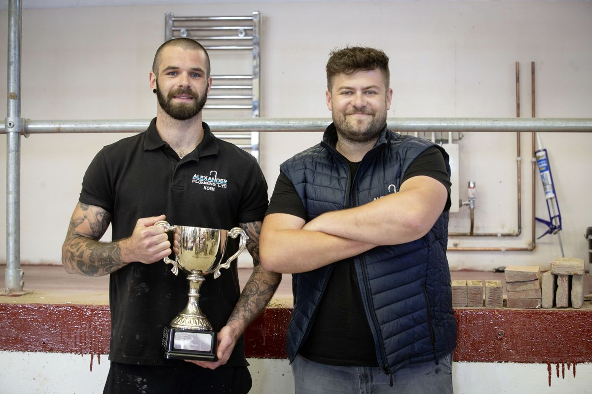 Keon Le Prevost, left, with boss Ross Alexander. Apprentice of the year award at the College of Further Education. (Picture By Cassidy Jones, 29636636)