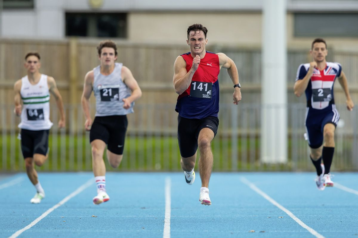 Joe Chadwick powers away from the field in the 200m. (Picture by Martin Gray, 29980085)