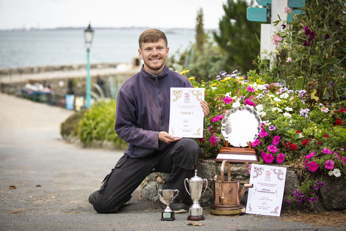 Liam Gaughan, head gardener on Herm, with the awards won in the Floral Guernsey Community competition. (Picture by Sophie Rabey 25981210)